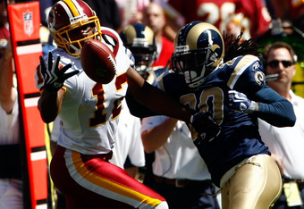 LANDOVER, MD - SEPTEMBER 20:  Malcom Kelly #12 of the Washington Redskins reaches for a reception against Jonathan Wade #20 of the St. Louis Rams  during their game on September 20, 2009 at FedEx Field in Landover, Maryland.  (Photo by Win McNamee/Getty I