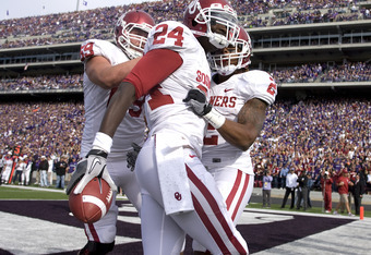 MANHATTAN, KS - OCTOBER 29:  Dejuan Miller #24 of the Oklahoma Sooners celebrates a 11-yard touch pass with teammates in the first quarter during a game against Kansas State at Bill Snyder Family Stadium on October 29, 2011 in Manhattan, Kansas. (Photo by