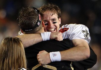 Drew Brees and Sean Payton embracing after the Saints emotional victory in Miami