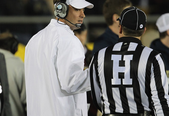 SOUTH BEND, IN - OCTOBER 22:  Head coach Lane Kiffin of the University of Southern California Trojans talks to a referee during a game against the Notre Dame Fighting Irish at Notre Dame Stadium on October 22, 2011 in South Bend, Indiana. USC defeated Not