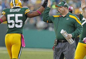 GREEN BAY, WI - OCTOBER 2: Head coach Mike McCarthy congratulates Desmond Bishop #55 of the Green Bay Packers after causing a fumble agaisnt the Denver Broncos at Lambeau Field on October 2, 2011 in Green Bay, Wisconsin.  (Photo by Matt Ludtke /Getty Imag