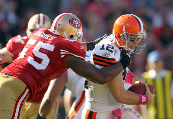 SAN FRANCISCO, CA - OCTOBER 30:  Colt McCoy #12 of the Cleveland Browns is sacked by Ahmad Brooks #55 of the San Francisco 49ers at Candlestick Park on October 30, 2011 in San Francisco, California.  (Photo by Ezra Shaw/Getty Images)