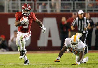 TUSCALOOSA, AL - OCTOBER 22:  Trent Richardson #3 of the Alabama Crimson Tide breaks out in open field away from Malik Jackson #97 of the Tennessee Volunteers at Bryant-Denny Stadium on October 22, 2011 in Tuscaloosa, Alabama.  (Photo by Kevin C. Cox/Gett