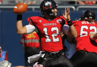 Chandler Harnish threw for 265 yards and ran for 133 yards in NIU's 63-60 victory over Toledo.
