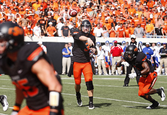 STILLWATER, OK - OCTOBER 8:  Quarterback Brandon Weeden #3 of Oklahoma State throws during the first half against Kansas University on October 8, 2011 at Boone Pickens Stadium in Stillwater, Oklahoma.  Oklahoma State defeated Kansas 70-28.  (Photo by Bret