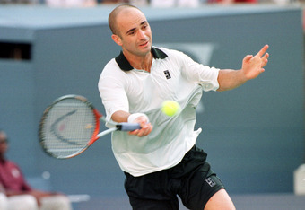 12 Sep 1999: Andre Agassi returns a shot to Todd Martin during the singles final of the US Open at the USTA National Tennis Center in Flushing Meadows, New York, New York.  Mandatory Credit: Clive Brunskill/ALLSPORT