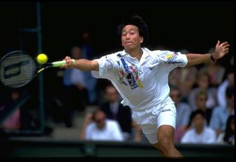 JUN 1993:  MICHAEL CHANG OF THE UNITED STATES LEAPS TO REACH THE BALL DURING A MATCH AT THE 1993 WIMBLEDON TENNIS CHAMPIONSHIPS.