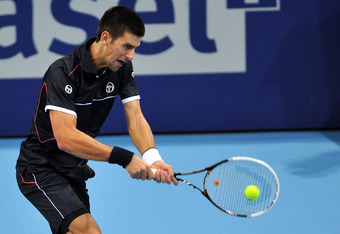 BASEL, SWITZERLAND - NOVEMBER 01:  Novak Djokovic of Serbia returns a shot in his match against Xavier Malisse of Belgium during day two of the Swiss Indoors at St Jakobshalle on November 1, 2011 in Basel, Switzerland.  (Photo by Harold Cunningham/Getty I