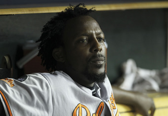 DETROIT - SEPTEMBER 22: Vladimir Guerrero #27 of the Baltimore Orioles watches the action from the dugout during the game against the Detroit Tigers at Comerica Park on September 22, 2011 in Detroit, Michigan. The Orioles defeated the Tigers 6-5. (Photo b