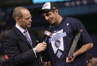 ST PETERSBURG, FL - OCTOBER 19:  Television personality Ernie Johnson talks with pitcher Matt Garza #22 of the Tampa Bay Rays after defeating the Boston Red Sox in game seven of the American League Championship Series during the 2008 MLB playoffs on Octob