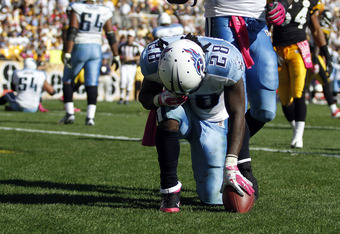 PITTSBURGH, PA - OCTOBER 9:   Chris Johnson #28 of the Tennessee Titans reacts to his touchdown against the Pittsburgh Steelers during the game on October 9, 2011 at Heinz Field in Pittsburgh, Pennsylvania.  The Steelers defeated the Titans 38-17.  (Photo