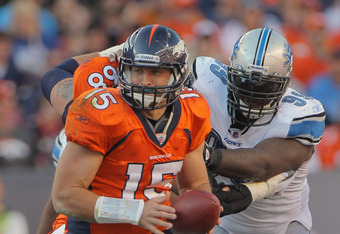 DENVER, CO - OCTOBER 30:  Quarterback Tim Tebow #15 of the Denver Broncos prepares to hand off the ball against the Detroit Lions at Sports Authority at Invesco Field at Mile High on October 30, 2011 in Denver, Colorado. The Lions defeated the Broncos 45-