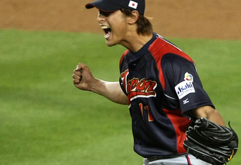 LOS ANGELES, CA - MARCH 23:   Relief pitcher Yu Darvish #11 of Japan reacts after getting the final out against Korea during the finals of the 2009 World Baseball Classic on March 23, 2009 at Dodger Stadium in Los Angeles, California. (Photo by Stephen Du