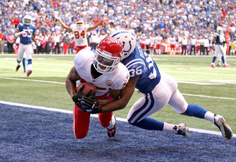 INDIANAPOLIS, IN - OCTOBER 09:  Steve Breaston #15 of the Kansas City Chiefs catches the game winning touchdown while defended by Chris Rucker #36 of the Indianapolis Colts during the NFL game at Lucas Oil Stadium on October 9, 2011 in Indianapolis, India