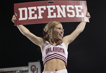 NORMAN, OK - OCTOBER 1:  An Oklahoma Sooner cheerleader performs during the second half against the Ball State Cardinals on October 1, 2011 at Gaylord Family-Oklahoma Memorial Stadium in Norman, Oklahoma.  Oklahoma defeated Ball State 62-6.  (Photo by Bre