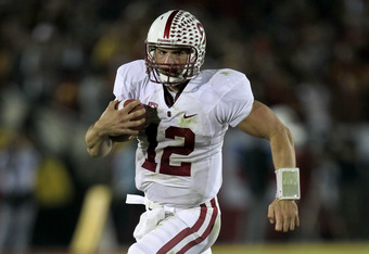 LOS ANGELES, CA - OCTOBER 29:  Quarterback Andrew Luck #12 of the Stanford Cardinal scrambles  against the USC Trojans at the Los Angeles Memorial Coliseum on October 29, 2011 in Los Angeles, California.  (Photo by Stephen Dunn/Getty Images)