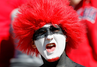 ATHENS, GA - OCTOBER 01:  A fan of the Georgia Bulldogs cheers prior to the game against the Mississippi State Bulldogs at Sanford Stadium on October 1, 2011 in Athens, Georgia.  (Photo by Kevin C. Cox/Getty Images)