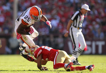 SAN FRANCISCO, CA - OCTOBER  Carlos Rogers #22 of the San Francisco 49ers tackles Chris Ogbonnaya #25 of the Cleveland Browns at Candlestick Park on October 30, 2011 in San Francisco, California.  (Photo by Ezra Shaw/Getty Images)