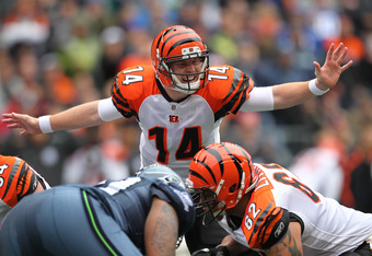 SEATTLE - OCTOBER 30:  Quarterback Andy Dalton #14 of the Cincinnati Bengals gestures at the line of scrimmage against the Seattle Seahawks at CenturyLink Field on October 30, 2011 in Seattle, Washington. (Photo by Otto Greule Jr/Getty Images)