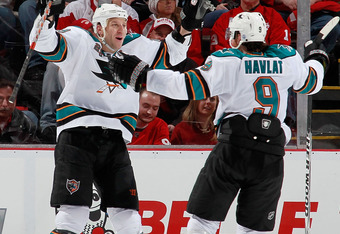 DETROIT, MI - OCTOBER 28:  Ryane Clowe #29 of the San Jose Sharks celebrates his second-period goal with teammate Martin Havlat #9 while playing the Detroit Red Wings at Joe Louis Arena on October 28, 2011 in Detroit, Michigan.  (Photo by Gregory Shamus/G