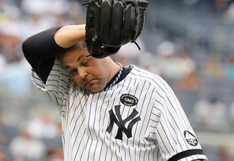 NEW YORK - JULY 25:  Joba Chamberlain #62 of the New York Yankees walks back to the dugout after retiring the Kansas City Royals during their game on July 25, 2010 at Yankee Stadium in the Bronx borough of New York City.  (Photo by Al Bello/Getty Images)