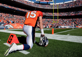 DENVER, CO - OCTOBER 30:  Quarterback Tim Tebow #15 of the Denver Broncos prays before a game against the Detroit Lions at Sports Authority Field at Mile High on October 30, 2011 in Denver, Colorado. (Photo by Justin Edmonds/Getty Images)