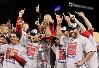 ST LOUIS, MO - OCTOBER 28: (L-R) Jon Jay #19, Allen Craig #21, Rafael Furcal #15 and Lance Berkman #12 of the St. Louis Cardinals celebrate with the World Series trophy after defeating the Texas Rangers 6-2 to win the World Series in Game Seven of the MLB