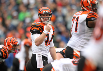 SEATTLE - OCTOBER 30:  Quarterback Andy Dalton #14 of the Cincinnati Bengals looks over the line of scrimmage against the Seattle Seahawks at CenturyLink Field on October 30, 2011 in Seattle, Washington. (Photo by Otto Greule Jr/Getty Images)