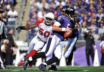 BALTIMORE - OCTOBER 30:  Joe Flacco #5 of the Baltimore Ravens fumbles on this play against the Arizona Cardinals at M&T Bank Stadium on October 30. 2011 in Baltimore, Maryland. The Cardinals lead the Ravens 24-6 at the half. (Photo by Larry French/Getty