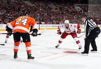 PHILADELPHIA, PA - OCTOBER 29:  Eric Staal #12 of the Carolina Hurricanes prepare to faceoff against Matt Read #24 of the Philadelphia Flyers on October 29, 2011 at Wells Fargo Center in Philadelphia, Pennsylvania. The Flyers defeated the Hurricanes 5-1.