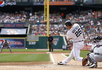 DETROIT, MI - AUGUST 21: Brennan Boesch #26 of the Detroit Tigers singles to left field in the first inning during the game against the Cleveland Indians at Comerica Park on August 21, 2011 in Detroit, Michigan.  (Photo by Leon Halip/Getty Images)