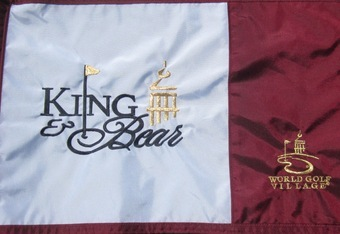 Flag of The King & The Bear showing affiliation with the Tower and the World Golf Hall of Fame.