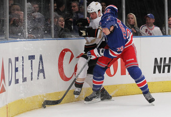 NEW YORK, NY - NOVEMBER 03:  Ruslan Fedotenko #26 of the New York Rangers battles Sheldon Brookbank #21 of the Anaheim Ducks  during their game on November 3, 2011 at Madison Square Garden in New York City.  (Photo by Al Bello/Getty Images)