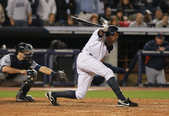 NEW YORK, NY - OCTOBER 06:  Curtis Granderson #14 of the New York Yankees hits a single in the bottom of the seventh inning against the Detroit Tigers during Game Five of the American League Championship Series at Yankee Stadium on October 6, 2011 in the