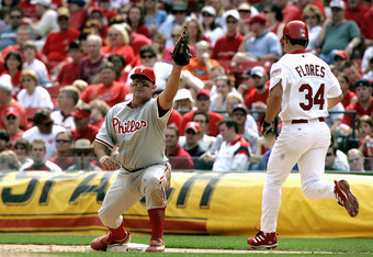ST. LOUIS - APRIL 9: First baseman Jim Thome #25 of the Philadelphia Phillies catches a throw ahead of baserunner Bobby Abreu #34 of the St. Louis Cardinals at Busch Stadium on April 9, 2005 in St. Louis, Missouri. The Phillies defeated the Cards 10-4.