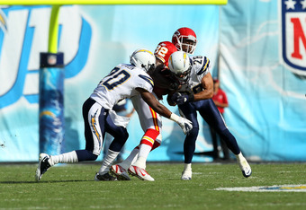SAN DIEGO - SEPTEMBER 25:  Wide receiver Dwayne Bowe #82 of the Kansas City Chiefs is tackled by safety Steve Gregory #28 and cornerback Antoine Cason #20 the San Diego Chargers at Qualcomm Stadium on September 25, 2011 in San Diego, California.    The Ch