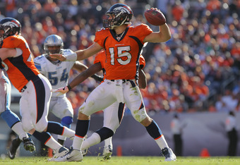 DENVER, CO - OCTOBER 30:  Quarterback Tim Tebow #15 of the Denver Broncos delivers a pass against the Detroit Lions at Sports Authority at Invesco Field at Mile High on October 30, 2011 in Denver, Colorado. The Lions defeated the Broncos 45-10.  (Photo by