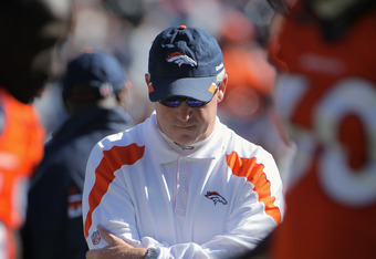 DENVER, CO - OCTOBER 30:  Head coach John Fox of the Denver Broncos looks on as the team warms up prior to facing the Denver Broncos Sports Authority at Invesco Field at Mile High on October 30, 2011 in Denver, Colorado. The Lions defeated the Broncos 45-