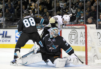 Evgeni Malkin's second goal deflected off the skates of Antti Niemi and Brent Burns