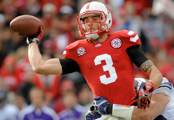 LINCOLN, NE - NOVEMBER 5: Quarterback Taylor Martinez #3 of the Nebraska Cornhuskers gets rid of the ball before being brought down during their game against the Northwestern Wildcats at Memorial Stadium November 5, 2011 in Lincoln, Nebraska.  (Photo by E