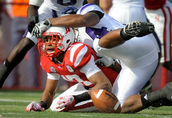 LINCOLN, NE - NOVEMBER 5: Cornerback Ciante Evans #17 of the Nebraska Cornhuskers scrambles after a fumble during their game against the Northwestern Wildcats at Memorial Stadium November 5, 2011 in Lincoln, Nebraska.  (Photo by Eric Francis/Getty Images)