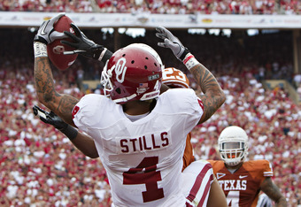 DALLAS, TX - OCTOBER 8:   Kenny Stills #4 of the Oklahoma Sooners  has a pass knocked out of his hands in the end zone by Carrington Byndom #23 of the Texas Longhorns at the Cotton Bowl on October 8, 2011 in Dallas, Texas.  The Sooners defeated the Longho