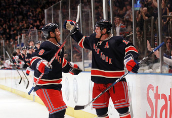 NEW YORK, NY - NOVEMBER 05:  Brad Richards #19 of the New York Rangers celebrates his goal with teammate Brandon Prust #8 against the Montreal Canadiens at Madison Square Garden on November 5, 2011 in New York City.  (Photo by Nick Laham/Getty Images)