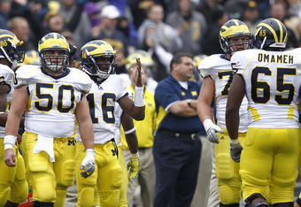 IOWA CITY, IA - NOVEMBER 5: Michigan Wolverines players react to an unfavorable replay review on a near touchdown late in the game against the Iowa Hawkeyes at Kinnick Stadium on November 5, 2011 in Iowa City, Iowa. Iowa held on to win 24-16. (Photo by Jo
