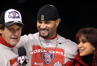 ST LOUIS, MO - OCTOBER 28:  (L-R) Manager Tony La Russa and Albert Pujols #5 of the St. Louis Cardinals celebrate after defeating the Texas Rangers 6-2 to win the World Series in Game Seven of the MLB World Series at Busch Stadium on October 28, 2011 in S