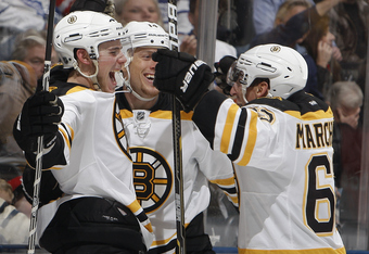 TORONTO, CANADA - NOVEMBER 5: Joe Corvo #14, Tyler Seguin #19, and Brad Marchand #63 of the Boston Bruins celebrate Seguin's third goal against the Toronto Maple Leafs during NHL action at The Air Canada Centre November 5, 2011 in Toronto, Ontario, Canada
