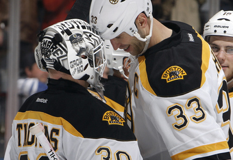 TORONTO, CANADA - NOVEMBER 5: Tim Thomas #30 and Zdeno Chara #33 of the Boston Bruins celebrate a 7-0 win against the Toronto Maple Leafs during NHL action at The Air Canada Centre November 5, 2011 in Toronto, Ontario, Canada. (Photo by Abelimages/Getty I