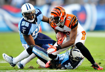 NASHVILLE, TN - NOVEMBER 06:  A.J. Green #18 of the Cincinnati Bengals makes a catch as Akeem Ayers #56 and Jason McCourty #30 of the Tennessee Titans defend during play at LP Field on November 6, 2011 in Nashville, Tennessee.  (Photo by Grant Halverson/G