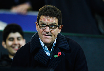 LONDON, ENGLAND - NOVEMBER 05:  England coach Fabio Capello takes his seat in the stands before the start of the Barclays Premier League match between Queens Park Rangers and Manchester City at Loftus Road on November 5, 2011 in London, England.  (Photo b