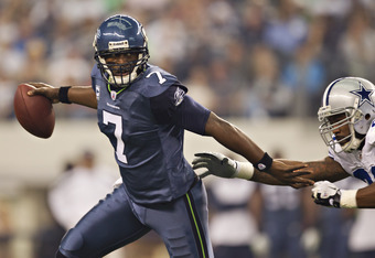 Tarvaris Jackson did well to evade the Cowboys pass rush. Jackson wasn't sacked, but did turn the ball over three times.